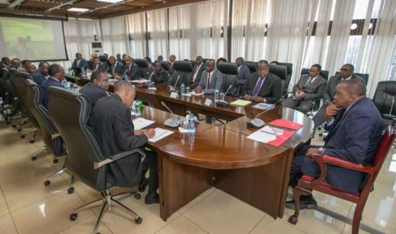 President Kenyatta walks from his office to meeting at Treasury