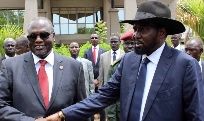 President Salva Kiir signs power-sharing deal with Riek Machar